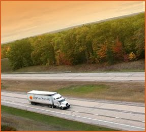 truck fleet driving on highway in florida with nice scenery
